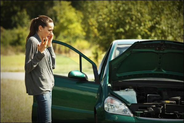 car breakdown on the road, woman calling for help on a cellphone